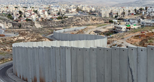 """The Israeli separation wall divides the Pisgat Zeev Israeli Settlement, on the left, and the Shuafat Refugee Camp, on the right, outside Jerusalem,  January 25, 2011. Al-Jazeera released leaked documents called the """"Palestine Papers"""" that reveal  that Palestinian negotiators were willing to compromise on the issues of Jerusalem and refugees during peace talks with Israel in 2008.  UPI/Debbie Hill"""
