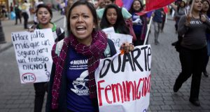 "A woman carries a banner  that reads in Spanish ""Duarte Femicide,"" referring to the Gov. of the State of Chihuahua Cesar Duarte, during a protest against violence against women marking International Women's Day in Mexico City, Tuesday, March 8, 2016. International Women's Day celebrates women and their accomplishments, but it also offers a stark reminder of the gender divides in rights, representation and pay. (AP Photo/Eduardo Verdugo)"